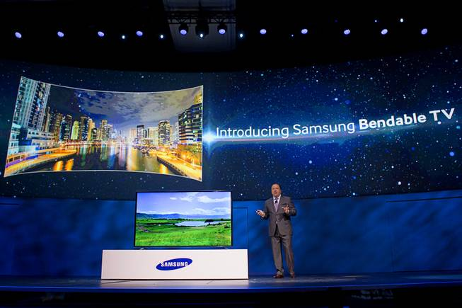 Joe Stinziano, executive vice president of Samsung Electronics of America, introduces a bendable television during the International Consumer Electronics Show (CES), in Las Vegas, Monday Jan. 6, 2014. The television changes from a flat screen to a curved screen at the touch of a button.