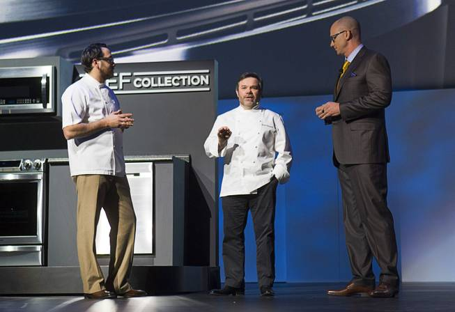 Chefs Christopher Kostow (L) and Michel Troisgros talk with Kevin Dexter, senior vice president of Samsung Electronics America, about the Chef Collection of kitchen appliances during the International Consumer Electronics Show (CES), in Las Vegas, Monday Jan. 6, 2014.