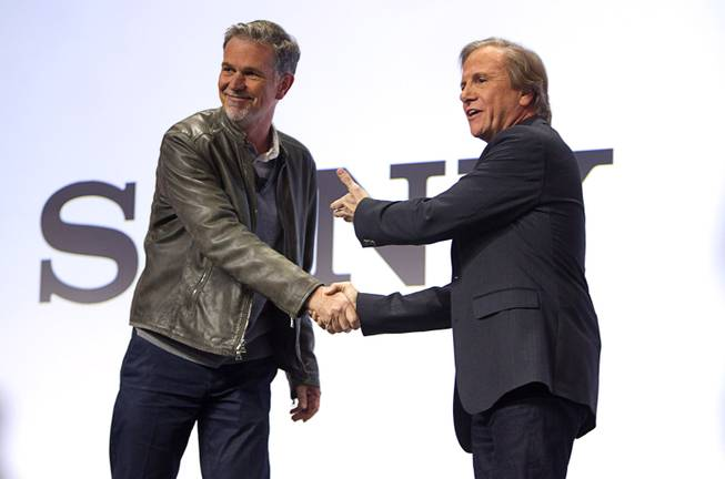 Netflix CEO Reed Hastings (L) shakes hands with Mike Fasulo, president and COO of Sony Electronics Inc., during a Sony news conference at the International Consumer Electronics Show (CES), in Las Vegas, Monday Jan. 6, 2014. Hastings talked with Fasulo about streaming 4K content.