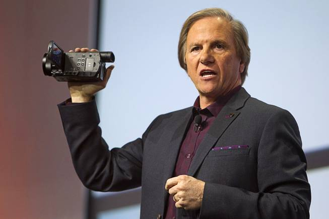 Mike Fasulo, president and COO of Sony Electronics Inc., holds a Sony FDR-AX100 4K camcorder during a Sony news conference at the International Consumer Electronics Show (CES), in Las Vegas, Monday Jan. 6, 2014. The camcorder is expected to retail for $2000.00, he said.