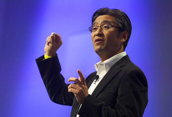 Kunimasa Suzuki, president/CEO of Sony Mobile Communications, holds a Sony Core during a Sony news conference at the International Consumer Electronics Show (CES), in Las Vegas, Monday Jan. 6, 2014. The wearable device will be able to record data about your activities and movement and display the information in a LifeLog app.