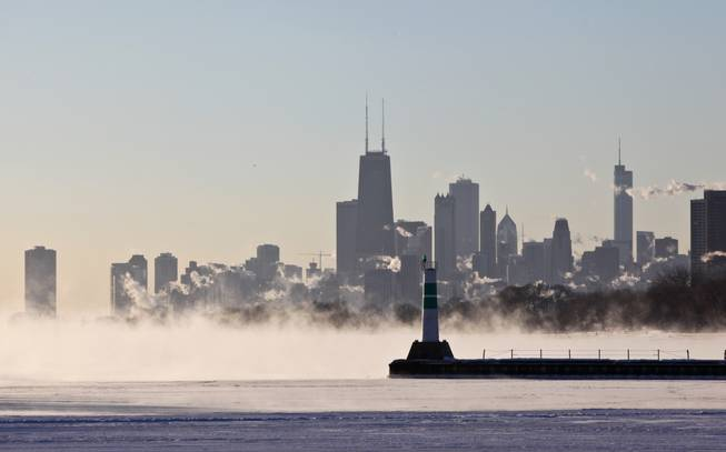 "A blanket of fog covers Lake Michigan along the Chicago shoreline Monday, Jan. 6, 2014 as temperatures dove well below zero and wind chills were expected to reach 40 to 50 below.  A whirlpool of frigid, dense air known as a ""polar vortex"" descended Monday into much of the U.S."