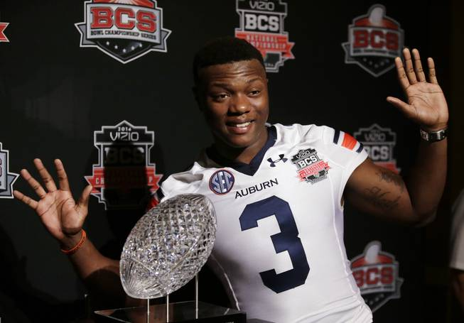 Auburn's Dominic Walker poses with The Coaches' Trophy during media day for the NCAA BCS National Championship college football game Saturday, Jan. 4, 2014, in Newport Beach, Calif. Florida State plays Auburn on Monday, Jan. 6, 2014.