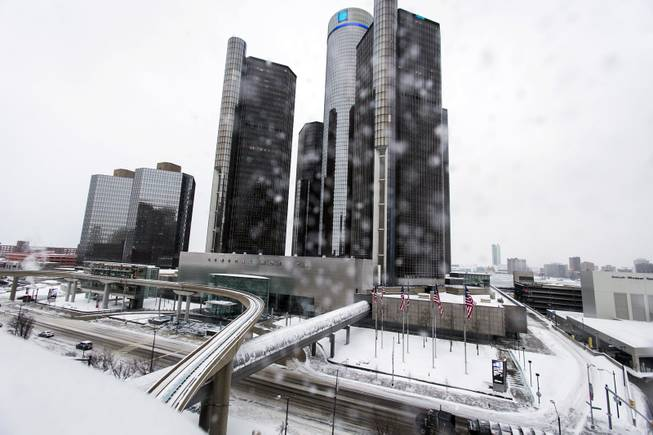 "Snow falls on Metro Detroit, Monday, Jan. 6, 2014, in Detroit. A whirlpool of frigid, dense air known as a ""polar vortex"" descended into much of the U.S. and plunged temperatures to record lows."