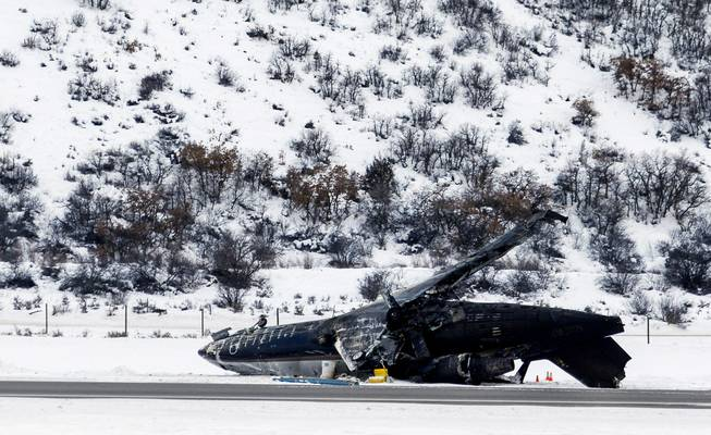 Colorado authorities say a fiery plane crash at the Aspen airport Sunday Jan. 5, 2014, killed one person and injured two others, one severely. Officials say the flight originated in Mexico and all three aboard were pilots and Mexican men.