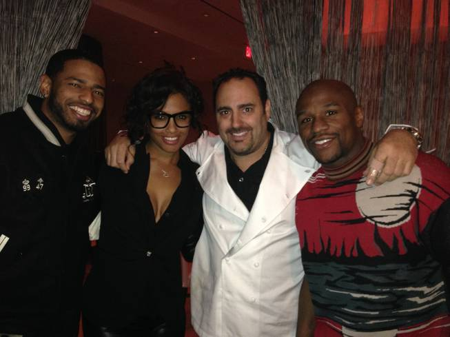 A guest, K.D. Aubert, chef Barry Dakake and Floyd Mayweather Jr. at N9NE Steakhouse in the Palms.