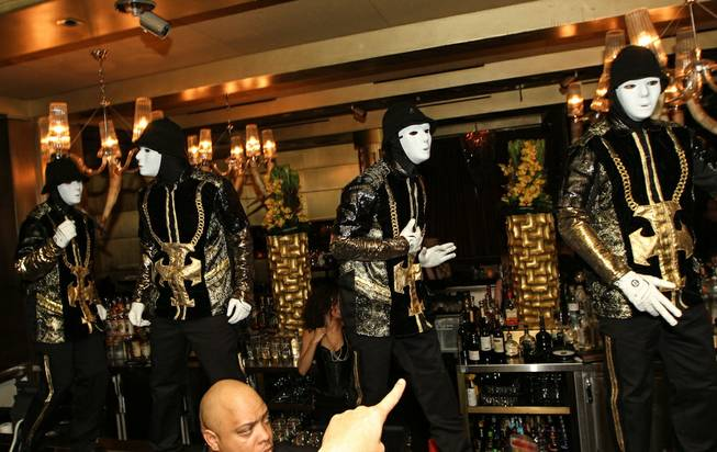 The Jabbawockeez perform at Gold Lounge on Tuesday, Dec. 31, 2013, in Aria.