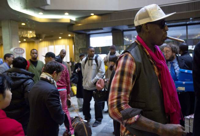 "Former NBA basketball star Dennis Rodman, right, and fellow U.S. basketball players arrive at a hotel in Pyongyang, North Korea Monday, Jan. 6, 2014. Rodman arrived in the North Korean capital with a squad of former basketball stars in what he calls ""basketball diplomacy,"" although U.S. officials have criticized his efforts."