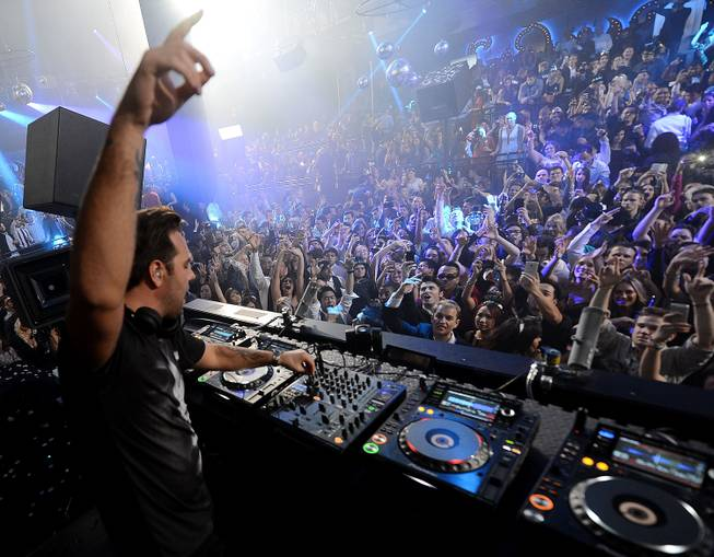 Sebastian Ingrosso spins at Light on Tuesday, Dec. 31, 2013, in Mandalay Bay.