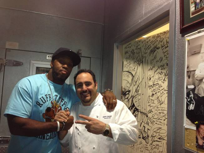 Terrell Suggs and chef Barry Dakake at N9NE Steakhouse in the Palms.