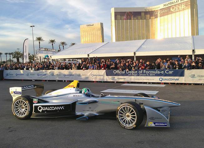 A new all-electric raceccar, the Spark-Renault SRT 01E Formula E, is taken on a demonstration drive by Brazilian Formula One driver Lucas di Grassi on the grounds of Mandalay Bay on Monday, Jan. 6, 2014.