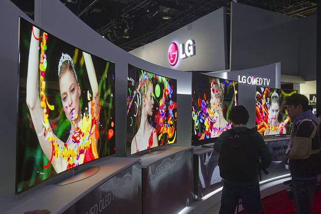 Curved 4K OLED televisions are displayed at the LG Electronics booth during the 2014 International Consumer Electronics Show (CES) at Las Vegas Convention Center in Las Vegas, Tuesday Jan. 7, 2014.