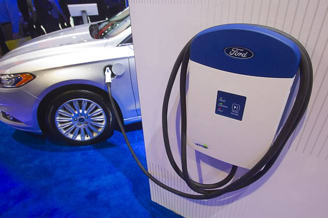 An electric vehicle charger is displayed at the Ford booth during the 2014 International Consumer Electronics Show (CES) at Las Vegas Convention Center in Las Vegas, Tuesday Jan. 7, 2014.