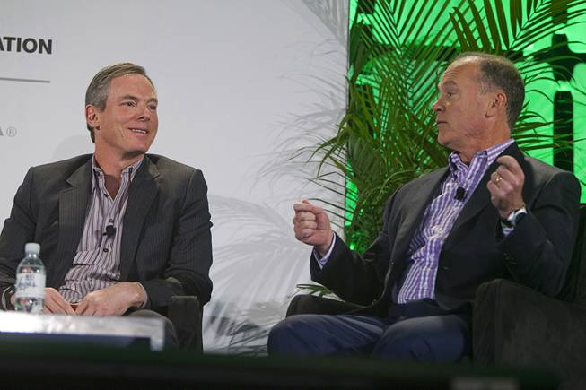 Paul Jacobs (L), chairman and CEO of Qualcomm, listens to John Donovan, senior vice president of technology and network operations for AT&T, during a panel discussion at the 2014 International Consumer Electronics Show (CES) in Las Vegas, Tuesday Jan. 7, 2014.