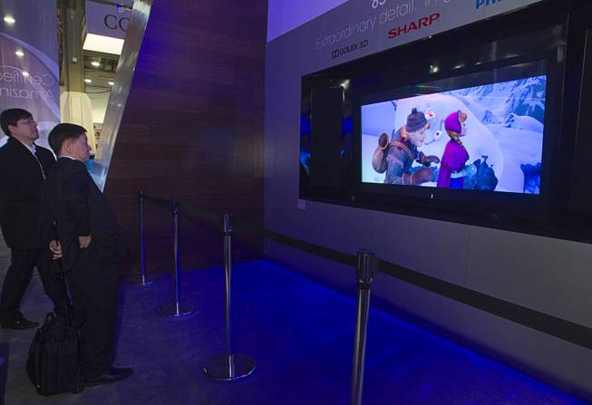 An 85-inch Sharp 8K glasses-free 3D television is displayed  during the 2014 International Consumer Electronics Show (CES) in Las Vegas, Tuesday Jan. 7, 2014.