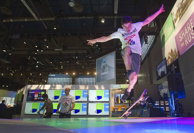 Skateboarder Peter Betti, 18, a member of the Polaroid Action team, performs at the Polaroid booth during the 2014 International Consumer Electronics Show (CES) in Las Vegas, Tuesday Jan. 7, 2014.