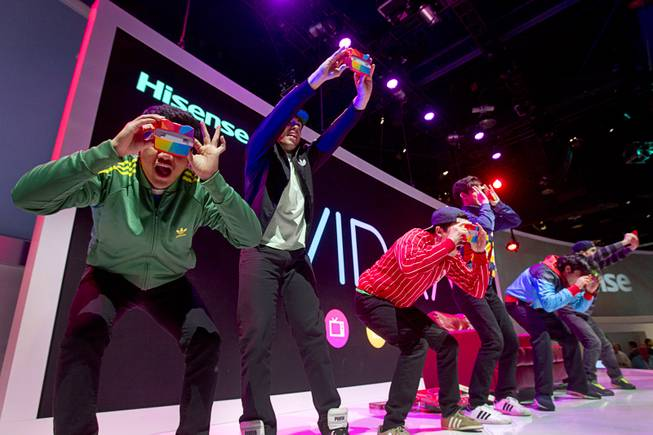 A dance group performs on the Hisense stage during the 2014 International Consumer Electronics Show (CES) in Las Vegas, Tuesday Jan. 7, 2014.