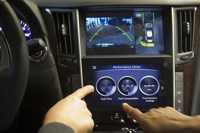 An Infiniti InTouch infotainment system is demonstrated inside an Infinity Q50S during the 2014 International Consumer Electronics Show (CES) in Las Vegas, Tuesday Jan. 7, 2014.