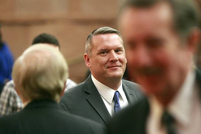 John Entsminger leaves the County Commission chambers after being named the new general manager for the Las Vegas Valley Water District Tuesday, Jan. 7, 2014.