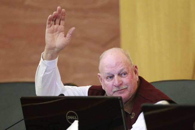 Commissioner Tom Collins raises his hand to make a motion during a meeting of the Las Vegas Valley Water District Board Tuesday, Jan. 7, 2014.
