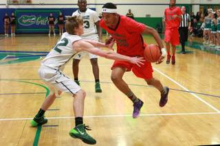 Las Vegas forward Tyler Bey prepares to drive past Green Valley forward Troy Cropper during their game Tuesday, Jan. 7, 2014.