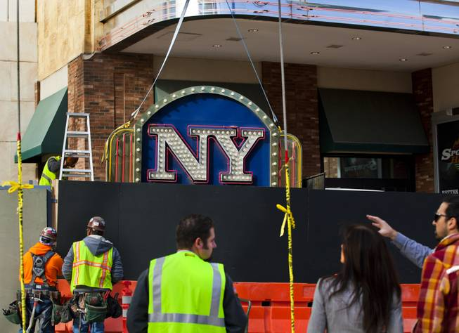 The New York - New York Hotel & Casino marquee entrance sign rests on a flatbed after being taken down by Yesco and donated to the Neon Museum on Tuesday, Jan. 7, 2014.