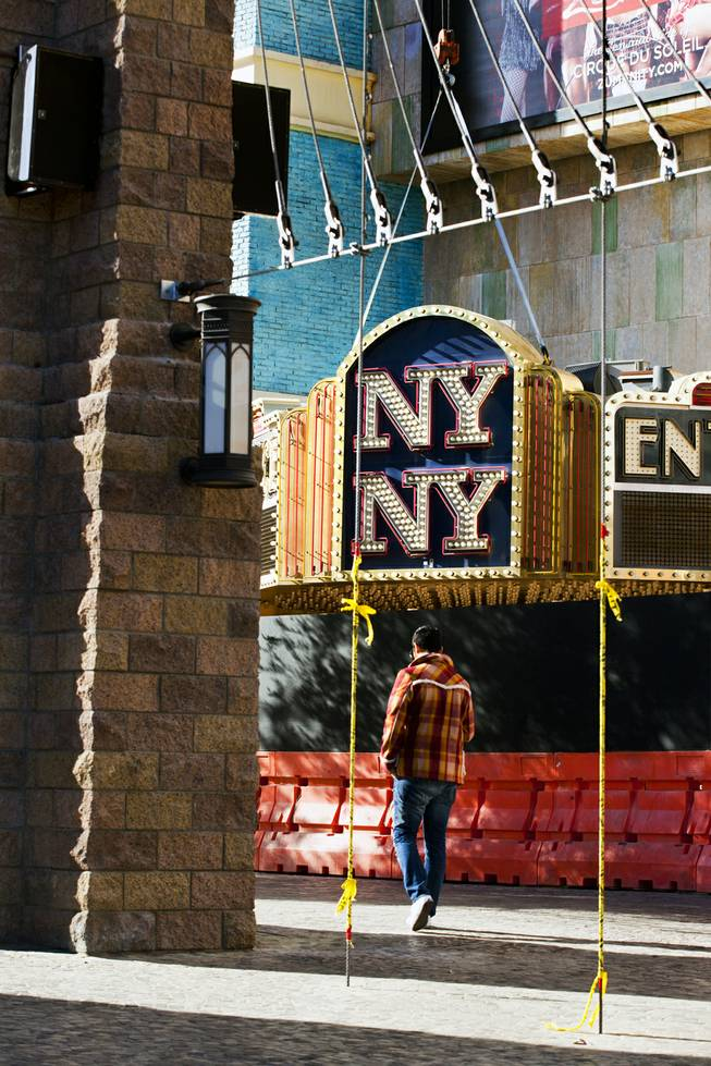 The New York - New York Hotel & Casino marquee entrance sign is readied to be taken down by Yesco and donated to the Neon Museum on Tuesday, Jan. 7, 2014.