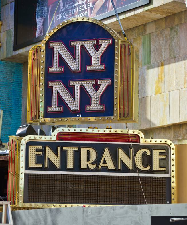 The New York - New York Hotel & Casino  marquee entrance sign is taken down by Yesco and donated to the Neon Museum on Tuesday, Jan. 7, 2014.