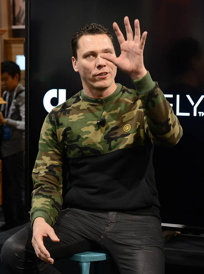 DJ Tiesto holds a press conference at the Audiofly booth to announce the Club Life by Tiesto line of in-ear headphones during the International Consumer Electronics Show on Tuesday, Jan. 7, 2014, in Las Vegas.