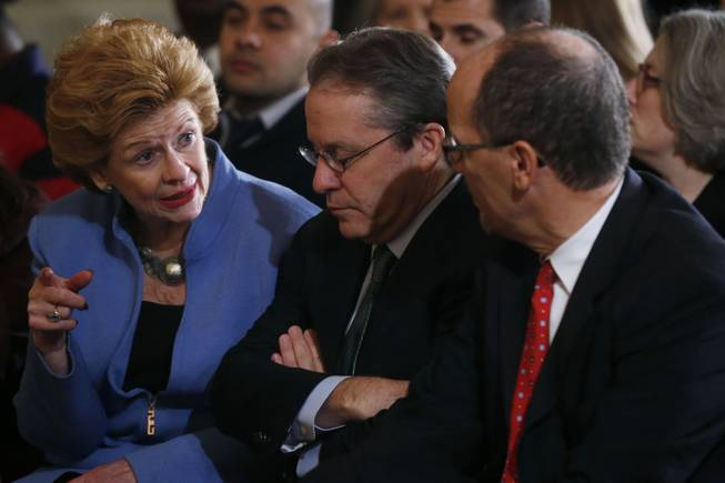 Sen. Debbie Stabenow, D-Mich., left, talks with White House National Economic Council Director Gene Sperling, center, as Labor Secretary Thomas Perez, right, before President Barack Obama spoke about benefits for the unemployed, Tuesday, Jan. 7, 2014, in the East Room at the White House in Washington.