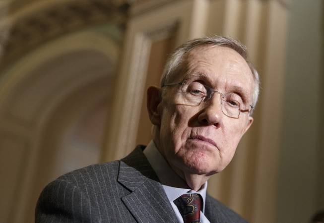 Senate Majority Leader Harry Reid pauses during a news conference on Capitol Hill in Washington, Tuesday, Jan. 7, 2014.