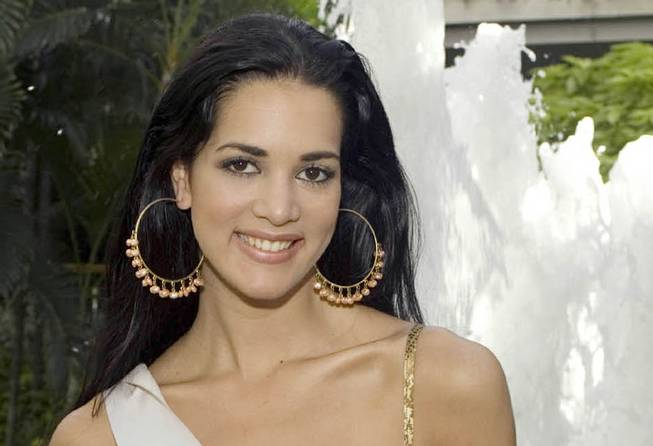 This May 23, 2005, file photo released by Miss Universe shows Monica Spear, Miss Venezuela 2005, posing for a portrait ahead of the Miss Universe competition in Bangkok, Thailand.