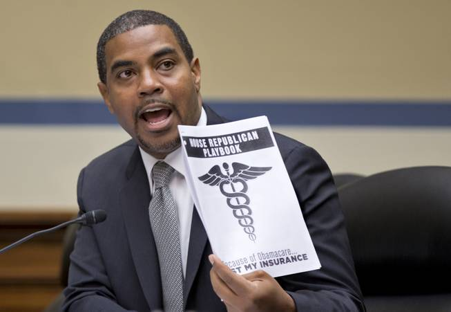 Rep. Steve Horsford, of Nevada, a Democratic member of the House Oversight Committee, holds a document called the House Republican playbook, which he waved in the direction of the GOP side of the committee during a hearing on the problems with implementation of the Affordable Care Act healthcare program, on Capitol Hill in Washington, Wednesday, Nov. 13, 2013.