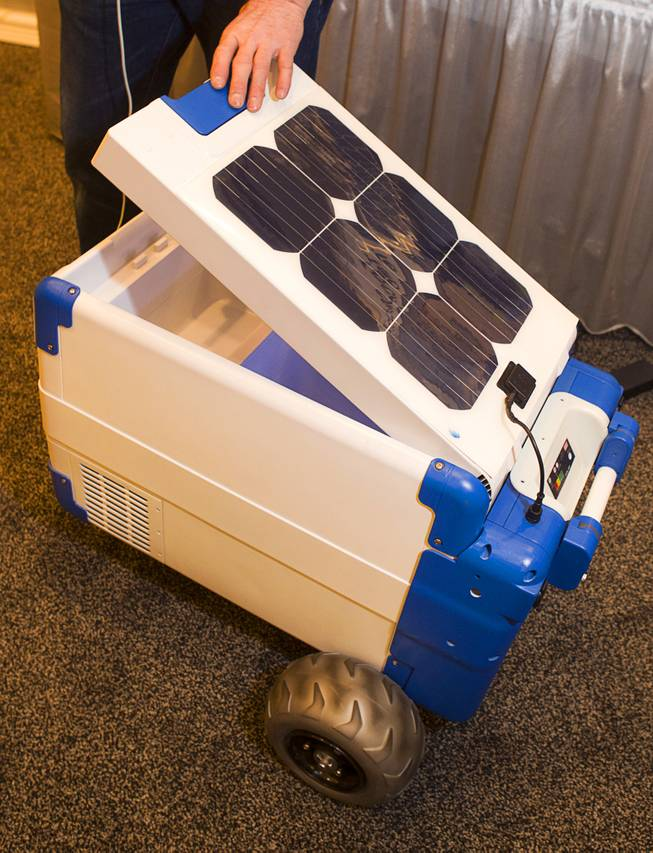 A Solar-Cooler, the worlds first portable, solar-powered refrigerated cooler, is displayed during the 2014 International Consumer Electronics Show (CES) in Las Vegas, Jan. 8, 2014. The cooler retails for $1,200 and includes USB and 12 volt outlets.