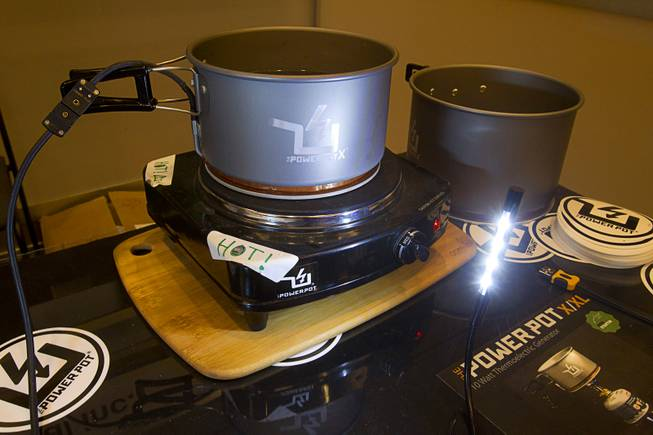 A PowerPot X uses thermoelectric technology to generate power for an LED light during the 2014 International Consumer Electronics Show (CES) in Las Vegas, Jan. 8, 2014. The pot which can charge two mobile devices at once through a USB port will retail for about $255.00 and is expected in stores in May 2014. The device is designed for outdoor enthusiasts.