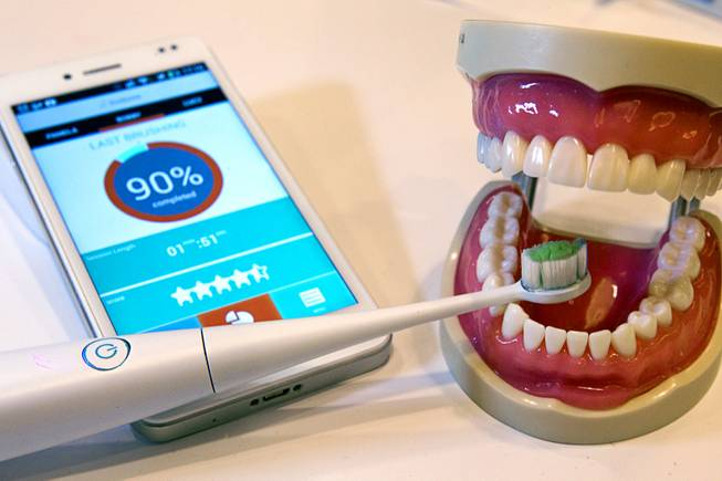 A Kolibree connected electric toothbrush is displayed during the 2014 International Consumer Electronics Show (CES) in Las Vegas, Jan. 8, 2014. The smart toothbrush uses an accelerometer, gyroscope and magnetometer to track how well the user brushes their teeth. The French company expects the toothbrush will be available in the third quarter of 2014 and retail for $99.00 to $199.00 depending on the model.