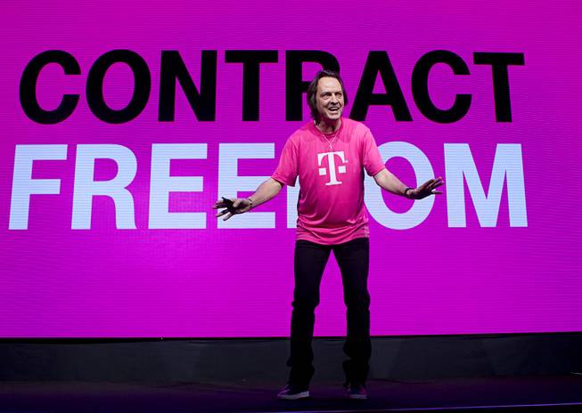 "T-Mobile CEO John Legere announces ""Contract Freedom"" during a news conference at the 2014 International Consumer Electronics Show (CES) in Las Vegas, Jan. 8, 2014. Legere said T-Mobile will pay Early Termination Fees (ETF) for families who transfer service from AT&T, Verizon, and Sprint."