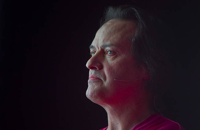 T-Mobile CEO John Legere waits as a video is played during a news conference at the 2014 International Consumer Electronics Show (CES) in Las Vegas, Jan. 8, 2014. T-Mobile announced they will pay Early Termination Fees (ETF) for families who transfer service from AT&T, Verizon, and Sprint.