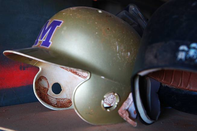 Of the batting helmets that weren't stolen from Sunrise Mountain High School, most are not usable because of lack of padding, such as this one seen Wednesday, Jan. 8, 2014.
