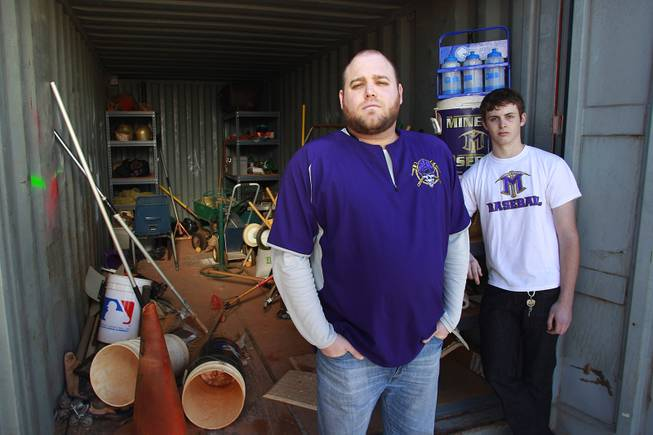 Baseball coach Nick Grove and player Bryce Durham stand next to the baseball storage shed at Sunrise Mountain High School on Wednesday, Jan. 8, 2014. At some point during the previous summer, the shed was broken into and almost everything was stolen.