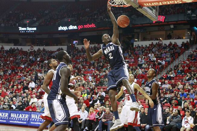 UNR guard Jerry Evans Jr. dunks on UNLV to finish the first half of their Mountain West Conference game Wednesday, Jan. 8, 2014 at the Thomas & Mack Center.