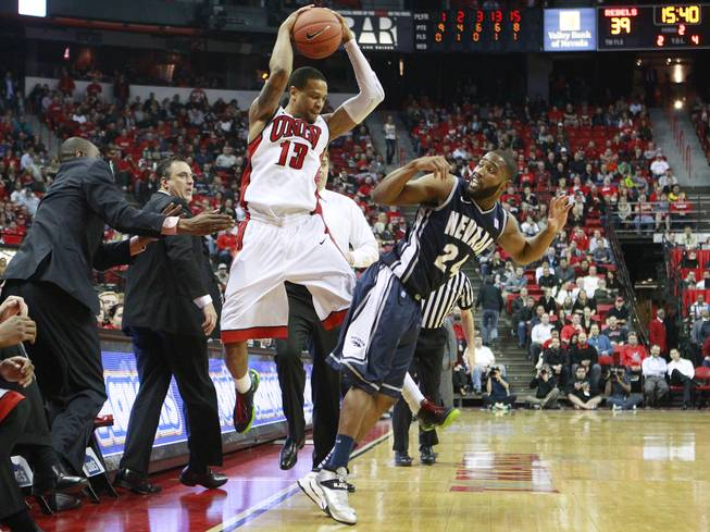UNLV guard Bryce Dejean Jones bounces the ball off UNR guard Deonte Burton to send it out of bounds during their Mountain West Conference game Wednesday, Jan. 8, 2014 at the Thomas & Mack Center. UNR won 74-71, handing the Rebels their second straight home loss.