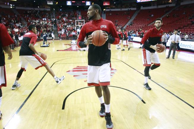 From left, UNLV forwards Chris Wood, Roscoe Smith and Carlos Lopez Sosa warm up for their Mountain West Conference game against UNR Wednesday, Jan. 8, 2014 at the Thomas & Mack Center