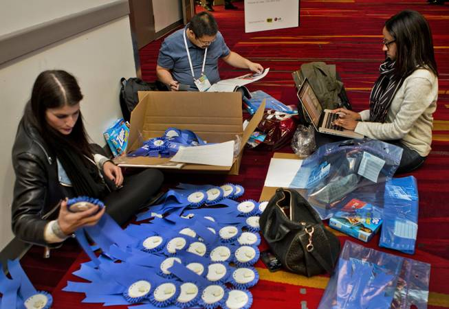 Blue ribbons are sorted and readied to be awarded to the top displays at CES in the Las Vegas Convention Center on Wednesday, Jan. 8, 2014.