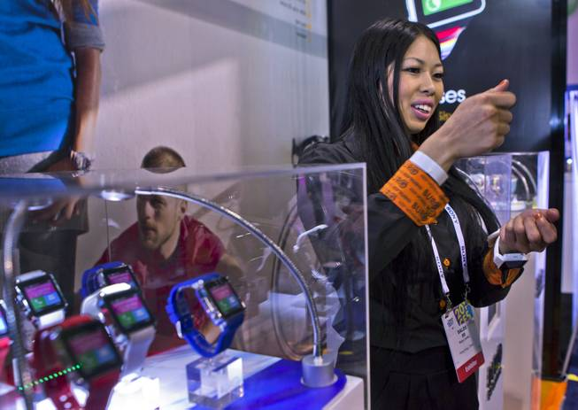 Karen Gabitanan talks about the new Burg Smartwatch technology she is showing in their display at CES within the Las Vegas Convention Center on Wednesday, Jan. 8, 2014.