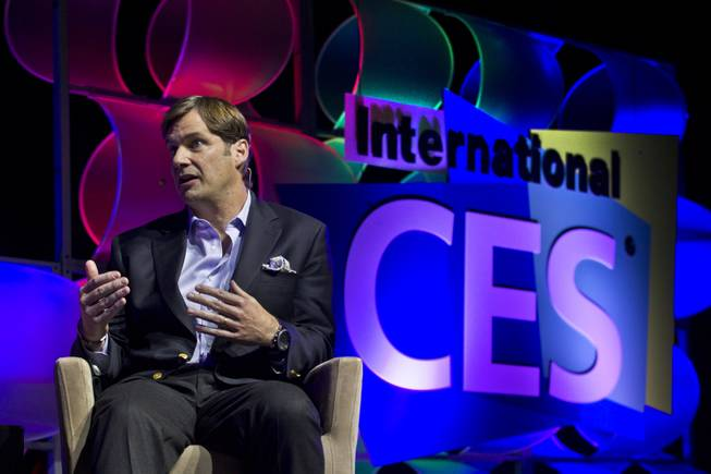 James D. Farley, Jr., EVP Global Marketing with Sales and Service at Lincoln and Ford Motor Company, answers a panel question during a CES speaking event in the LVH Theatre on Wednesday, Jan. 8, 2014.