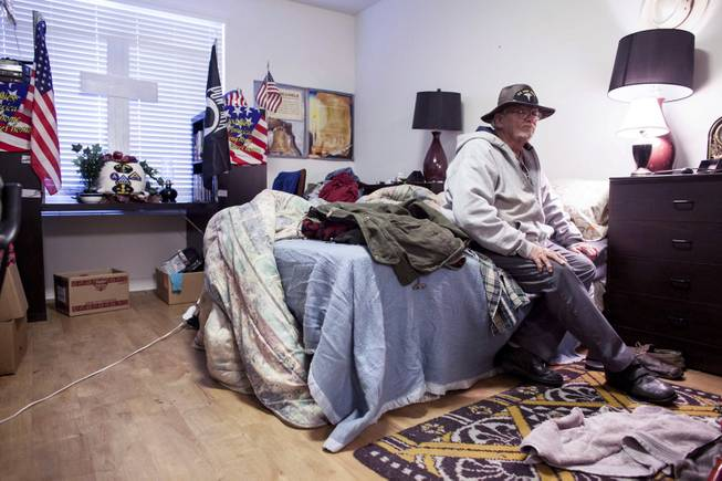 George Reimiller keeps a shrine in his studio apartment for his fellow veterans, including a brother who died in Vietnam, at Victory Place, a community for former servicemen in Phoenix, Jan. 8, 2014.