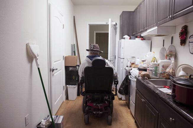George Reimiller, an Army veteran, leaves his studio apartment at Victory Place, a community for homeless servicemen in Phoenix, Jan. 8, 2014.
