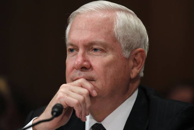 In this June 15, 2011, file photo, then-Secretary of Defense Robert Gates testifies regarding the Department of Defense Fiscal Year 2012 budget request before the Senate Appropriations Committee Subcommittee on Defense on Capitol Hill in Washington.