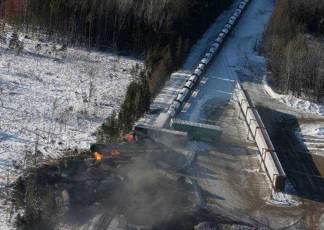 This aerial photo shows derailed train cars burning in Plaster Rock, New Brunswick on Wednesday, Jan. 8, 2014. A Canadian National Railway freight train carrying crude oil and propane derailed Tuesday night in a sparsely populated region of northwestern New Brunswick. More than 100 residents remained evacuated from their homes. There were no deaths or injuries.